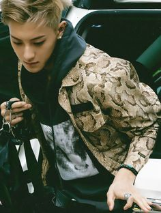 Tao - Exo  Leave it to him to make snakeskin look good.