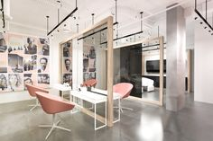 Zu Hair Salon Waterfront Building, Calgary 2014  Taking cues from Scandinavian design trends,this boutique hair salon highlights the base building architecture of the space with its minimalist design, simple fixturesand muted color palette.