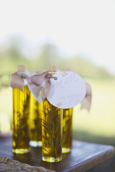 Herb olive oil as favors (DIY!) glass bottles (we used these cork top bottles) olive oil sprigs of rosemary 1) Place 1 sprig of rosemary in each bottle. 2) Using a small funnel to prevent spillage, pour the olive oil into the bottles. 3) Finish off with a favorite ribbon and you're ready to go!