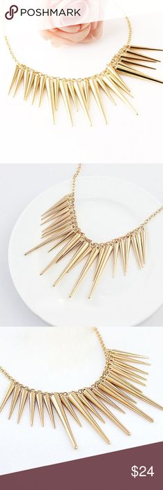 Just In!🎉 Gold Spike Statement Necklace✨ Just In! There is literally no bad way to wear this badass necklace. With a t-shirt, sweater, party dress...you'll reach for it constantly! Lightweight and comfy to wear, with subtly rounded edges so they won't snag on your clothes....it's the perfect cross between luxe and edgy. You'll love wearing it! Brand new boutique item, comes wrapped up in a jewelry box, ready to be enjoyed by you or someone in your life!🎁 Perfect for every holiday party…