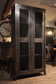 I like the amount of metal on this one. Instead of the chicken wire doors, perhaps rustic wood panels. Garage Furniture, Steel Furniture, Cabinet Furniture, White Furniture, Cheap Furniture, Industrial Furniture, Furniture Design, Furniture Ideas, Shop Cabinets