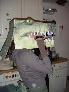 crocodile costume - made with a cardboard box - go to http://www.wikihow.com/Make-a-Crocodile-Costume for instructions - I added some modrock to build up surface, then hand painted.  Also made a tail with green leathery fabric