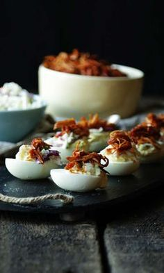 Deviled Eggs with Slow Cooker BBQ Pulled Chicken and Creamy Coleslaw. You won't find a better tailgating treat!