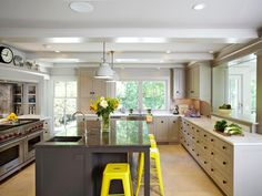 The kitchen design experts at HGTV.com share 17 kitchens without upper cabinets that instead use open shelving or windows with a view.