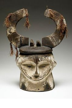 Africa | Helmet mask from the Fang people of Gabon | Wood, raffia and pigment | 20th century