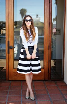 Striped skirt, graphic sweater, statement necklace