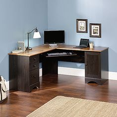 Melamine top surface is heat, stain, and scratch-resistant. Slide-out keyboard/mouse shelf with metal runners and safety stops.  Lower drawer holds letter or European size hanging files. Storage area behind the door holds a vertical CPU tower.  The door and drawers can be fastened on the left or right side. Grommet hole for cord management.  This corner computer desk comes in an Antiqued Paint finish with American Cherry accents.