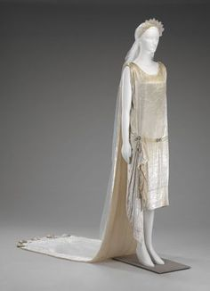 Wedding dress, chemise, train, veil. American, 1925. Silk velvet, silk satin, linen lace, silk net, glass pearls & rhinestones.