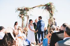 Colorful Coastal Wedding with gorgeous floral chuppah Photo by @studiocastillero Coordinated by: @ro&coevents Photo booth by @unionbooth