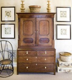 The scale in this photo is perfect. The dresser os closet is not to big and it is also not to small. I think it fits nicly in this space.