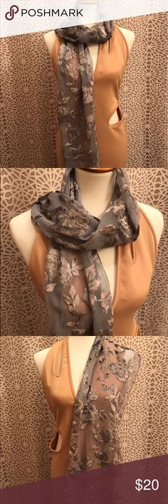 Beautiful Blue Floral NY & CO Scarf So stunning! The color is a blue that reads somewhat silver depending on the lighting you are in. 40% polyester and 60% rayon. New York & Company Accessories Scarves & Wraps