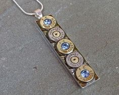 Centerpiece pendant has dimension of 6.5X4.5 cm. Antiqued sterling plate chain measures 16 inches with a 2 inch extension for wear between 16 and