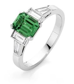 18ct White Gold Tsavorite Garnet & Diamond Ring      Emerald cut tsavorite garnet in a 4 claw setting with baguette diamond and tapered baguette diamond rubover set on 3 sides. The tapered baguette setting blends into the flat white gold band.      Can also be made in yellow gold or platinum.       Can be made using other coloured gemstones.