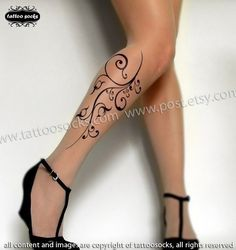 Sexy Flora Tattoo thigh-high socks from Tattoosocks on Etsy. I think I may like their octopus stockings even more than this design, but this one is probably a better fit for the office dress code.