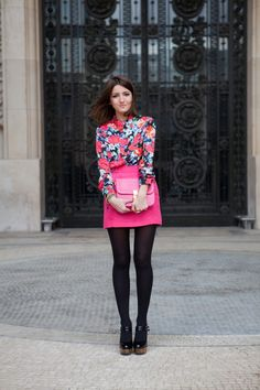 From Paris Fashion Week: Blogger Alexandra plays camouflage with her purse. Photo by The Locals