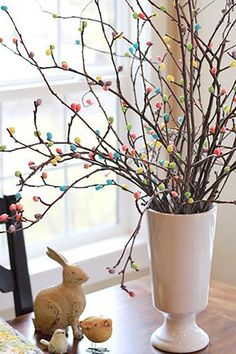 Simply hot-glue jelly beans to the ends of branches to create a jelly bean tree that's as attractive as it is delicious.  Get the tutorial at Crafty Sisters.