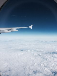 Above the clouds of Melbourne from the wing of a plane