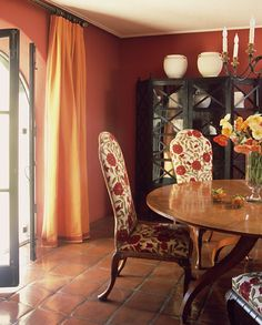 gorgeous dining room combination of orange / coral with a pale