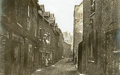 Lower Fore Street, a narrow cobblestoned street in Lambeth, pictured in 1865.    This industrial area became very densely populated over the Victorian    period; its inhabitants rose from 28,000 in 1801 to nearly 300,000 by the    time this photograph was taken.