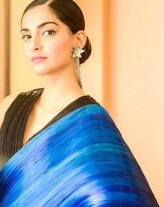 Sonam Kapoor in a black and blue sari by designer Rimzim Dadu paired with a tight bun and a black collar necklace. #Bollywood #Fashion #Style #Beauty #Sexy