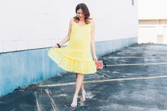 A yellow swing dress for a pop of color in your summer wardrobe #maternityfashion #rebeccaminkoff