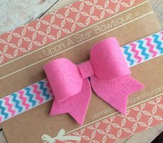 Felt bow headband in pink by UponAStarBowtique on Etsy