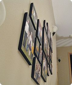 """Make your own wall canvases - 1"""" styrofoam insulation covered with black fabric, stapled down, duct taped, spray adhesive or mod podge on photos & hang"""