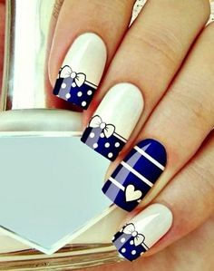 Navy and White Nails with Polka Dots , Stripes and Bows.