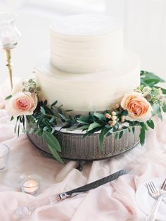 Floral accented classic white wedding cake: http://www.stylemepretty.com/maryland-weddings/stevensville-maryland/2015/11/20/classic-romantic-wedding-at-the-chesapeake-bay-beach-club/ | Photography: Krista A Jones - http://kristaajones.com/