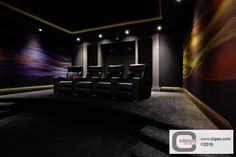 Home theater. Materials: Acoustic translucent printed fabric for the walls (495 AT) and acoustic translucent (495 AT) fabric for the screen. Installer: The Big Picture-Birmingham, UK.