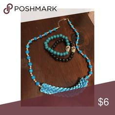 Turquoise Beaded Necklace & Skull Bracelet Combo Turquoise and silver plastic beaded adjustable necklace with two wooden beaded stretch bracelets with skull gem detail. Jewelry