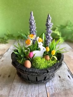 This lovely miniature garden planter will add a touch of spring to your dollhouse or fairy garden. Blooming with handmade clay daffodils and tulips, faux lavender, moss and faux greens this little planter is pretty and petite. Speckled Easter eggs and a tiny hand painted wooden bunny