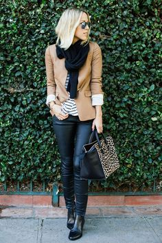 A classic Fall outfit featuring leather pants and a blazer. Love! Top off the look like she did with a black scarf and leopard handbag!