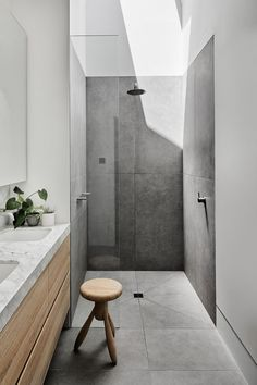 Prahran Residence Pipkorn Kilpatrick cc Tom Blachford bathroom. the bathroom with a mix of timber, Carrara, stone tiles, white joinery, internal windows and skylights again to maximise natural light flow