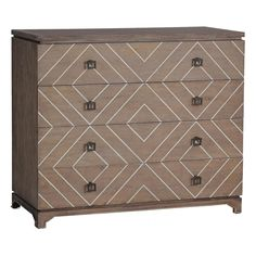 <b>Materials: Oak with bone inlaid creating geometric pattern Finish: Natural Oak & White Bone</b>  Our Terrance Transitional Chest is the perfect example of transitional style. We took a postmodern, modular-style dresser made of oak, and added a bone inlay to create a unique geometric pattern that catches the eye.