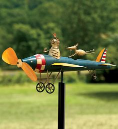 "Fun Kinetic Art For Your Yard    The slightest breezes send kinetic art whirligigs into a flurry of motion. Even when still, our all-metal, handcrafted whirligigs add fanciful fun to your garden. Includes three-part 46-1/2"" metal pole. (Plow & Hearth $39.95)"
