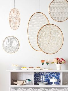 Lace mobiles using gold-painted embroidery hoops. Would be a nice statement wall-art piece. ~w