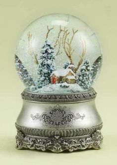 """""""Cozy Cottage Snowglobe"""" - A humble homestead nestled within the pines, dusted by random flurries.  Plays """"I'll Be Home for Christmas""""  Available from The Victorian Trading Company"""