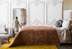 This modern mix of baroque ( the wall panels) and art deco ( the bed spread) in a neutral palette makes for a perfect expression of contemporary vintage styling.