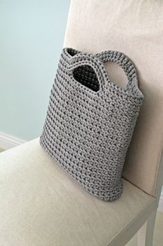 This is a handmade crochet tote bag. It will be perfect for your trip to the beach or to the town! This bag made from grey color polyester rope