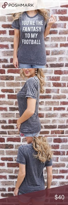 n e w  you're the fantasy to my football tee You're The Fantasy To My Football – Acid Wash – Gray Tee  Watch your favorite sport with your favorite person in our softest tee ever. You won't want to take it off!  52% Cotton, 48% Polyester  Wash cold and hang to dry to maintain best quality. Do not iron over the letters. After your tee is dry, tumble it on low to remove any wrinkles.  Gray Acid Wash  Model is wearing a size small. Boutique Tops Tees - Short Sleeve