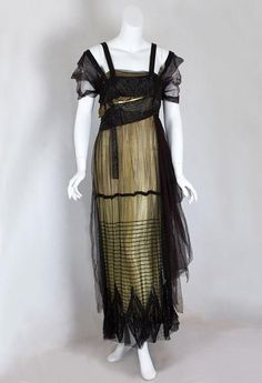 Evening Dress, B. Altman: ca. 1912,  beaded lamé, the outer layer of silk tulle is sculpted with asymmetrical draping and floats over a straight lamé under dress.