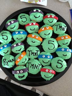 Tmnt birthday cupcakes ... The bandana is an Airhead candy cut in half and the eyes are Wilton's and were in the baking aisle at my grocery store. Super easy!!