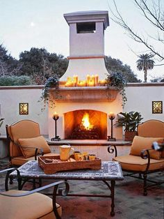 Add a great entertaining and relaxing feature to your backyard with an outdoor fireplace. We have plenty of ideas to suit your style and size of yard or patio. From portable fire pits to a large, stone outdoor fireplace, you'll find plenty of ideas. Outdoor Fireplace Designs, Backyard Fireplace, Outdoor Fireplaces, Fireplace Ideas, Stucco Fireplace, Propane Fireplace, Fireplace Seating, Modern Fireplace, Outdoor Living Rooms