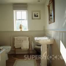 Picture - Traditional cream bathroom with tongue+groove dado panelling. Fotosearch - Search Stock Photography, Photos, Prints, Images, and P. Cream Bathroom, White Bathroom Decor, Modern Bathroom, Small Bathroom, Bathroom Ideas, Bathroom Designs, Luxury Bathroom Vanities, Master Bathroom Vanity, Downstairs Bathroom