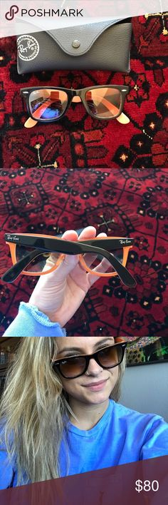Ray Ban Wayfarer sunglasses Ray Ban wayfarer sunglasses. In a color that's not currently sold. Outside is black but has a pop of orange that comes through form the inside (shown in the 3rd photo). Comes with original case! Authenticity shown in last photo! Ray-Ban Accessories Sunglasses