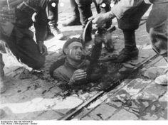 Polish insurgent fighter surrendered from his position in the sewers under Warsaw, Poland, 27 September 1944. Note MP 40 submachine gun. http://wrhstol.com/2zgnaYy