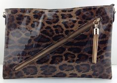 CA$37.95 - Diagonal zip clutch Leopard Brown. Fab oversized bag! Love the tassel.