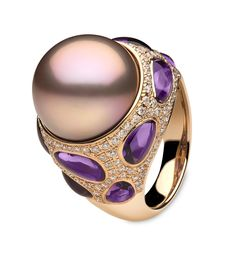 Yoko London Calypso collection rose gold ring featuring a pink freshwater pearl surrounded by amethysts and diamonds.