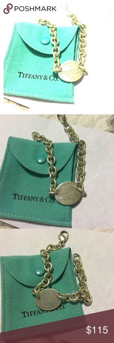 Return to Tiffany bracelet Return to Tiffany & co. Bracelet. It does have a few scratches on the front and has my initials engraved on the back Tiffany & Co. Jewelry Bracelets
